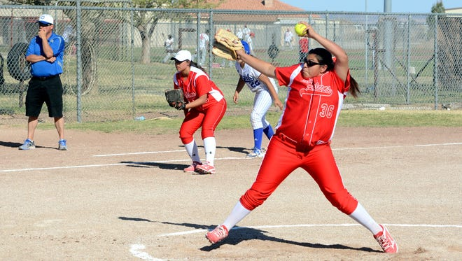 Loving's Larissa Martinez throws a pitch in game one Tuesday against Carlsbad JV.