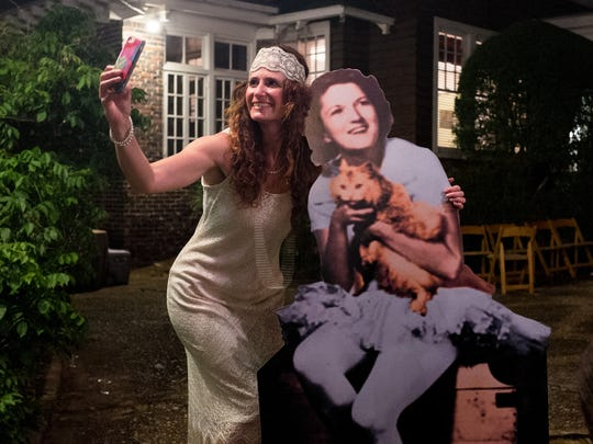 Deanna Acklin, left, with a cut-out a photo of Zelda Fitzgerald.