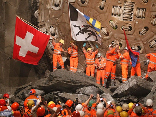 Miners wave  flags as  they celebrate after a drill