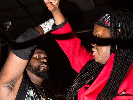 "Anthony Buggs, who wrestles as ""TIP Duane Anthony,"" left, and Chris Scruggs, who wrestles as ""Hollyhood,"" celebrate during the Ultimate Championship Pro Wrestling South event on July 6 at the Rec Room."