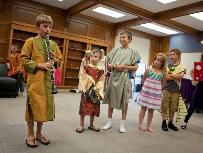 Ben Adair, 11, plays a song on the clarinet as others smile and lean in to watch during the Curtain Call Kids of Port Huron Civic Theater rehearsal of A Midsummer Night's Dream August 20, 2014 at the Clara E. Mackenzie Building on the campus of SC4. The play will be held August 23 at 7 p.m. in McMorran Place Theater.