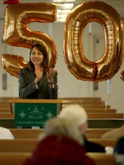 Washington State Ferries Director Amy Scarton leads a round of applause Thursday during the 50th birthday event for the ferry Hyak at Eagle Harbor Maintenance Facility.