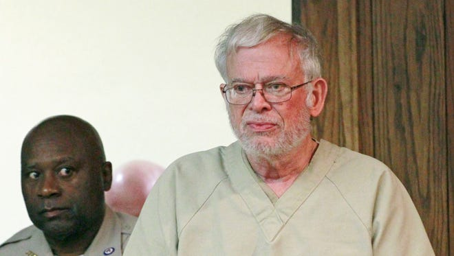 Dr. Ralph Arnold Smith Jr., 70, walks into a Leflore County Court in Greenwood, Miss., Wednesday, May 16, 2012, for a preliminary hearing during which it was determined there was enough probable cause for his case to be turned over to a grand jury. Smith Jr. will remain in jail without bond, the judge ruled Wednesday. Smith  is charged with conspiring to kill attorney Lee Abraham, who represented Smith's ex-wife during the couple's divorce in the 1990s. (AP Photo/Rogelio V. Solis)