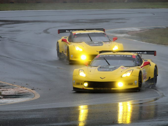 Corvettes racing in the rain.