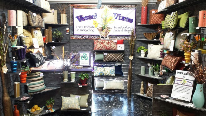 Vessel Vixen at Flamingo Island Flea Market in Bonita Springs sells handmade home decor accessories made from recycled materials.