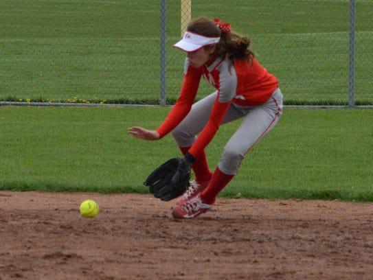 Canton junior second baseman Sydney Dawson fields a