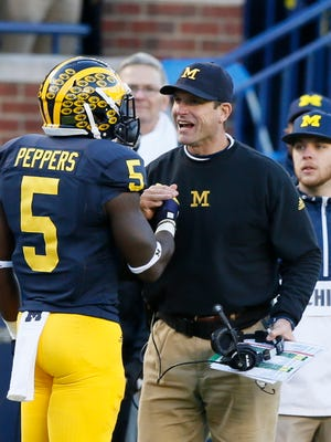 Michigan Jabrill Peppers gets a smile and handshake from head coach Jim Harbaugh after Peppers touchdown against the Rutgers in the second quarter on Saturday, November 7, 2015, in Ann Arbor. Julian H. Gonzalez/Detroit Free Press