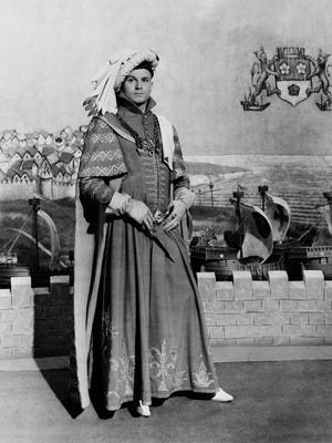 """Laurence Olivier is seen in Shakespeare's """"Henry V,"""" which he also directed, in a production for the Two Cities Films studios in England."""