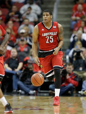 Cardinal Wayne Blackshear drives the ball down the court during the scrimmage. He hauled down 11 rebounds and scored 20 points. Six new freshmen have joined the roster this year.