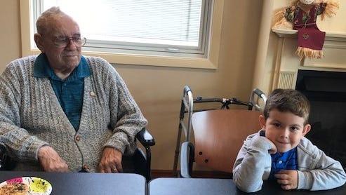Paul Mospens and Pavle Sebez, 3, of Villa Hills, enjoy each other's company.
