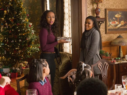 "Keri Hilson and Gabrielle Union in ""Almost Christmas."""