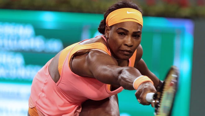 Serena Williams reaches to return serve to Timea Bacsinszky of Switzerland on Wednesday at the BNP Paribas Open in Indian Wells.