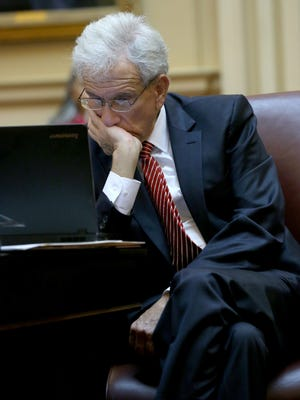 Senate Minority Leader Richard L. Saslaw, D-Fairfax, looks at his computer screen during presentation of the Senate budget bill during the floor session of the Virginia Senate at the State Capitol in Richmond, Va., Thursday, Feb. 12, 2015. (AP Photo/Richmond Times-Dispatch, Bob Brown)