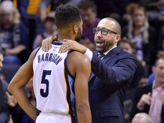 Memphis Grizzlies head coach David Fizdale, right, talks with Memphis Grizzlies guard Andrew Harrison (5) in the second half of an NBA basketball game against the Golden State Warriors, Saturday, Dec. 10, 2016, in Memphis, Tenn. (AP Photo/Brandon Dill)