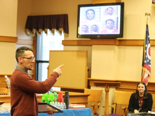 "Jeffery Schill, at his Drug Court graduation, points to several mugshots from when he was using drugs and said he does ""not want to be in that picture again."""