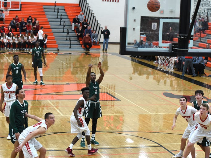 A Novi Wildcat sinks a number of free-throws at the