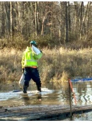Property owner Kathy Wolfe Friday photographed a Rover Pipeline worker carrying sand bags at the Black Fork of the Mohican River on her 400-plus acre property which sits in Ashland and Richland County.