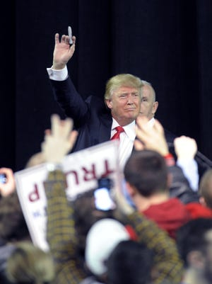 Republican presidential candidate Donald Trump waves to the crowd at a rally held at the Mabee Center in Tulsa, Okla. on Jan. 20.
