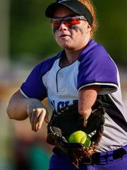Pavey uses her left arm to pull her glove off of her right hand as she retrieves the ball to throw in to the infield. She has been timed and only lacks .2 seconds from others players at making the transition from ball to hand. May 15, 2017