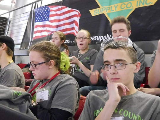 Franklin County 4-H Robotics Club members watch competition