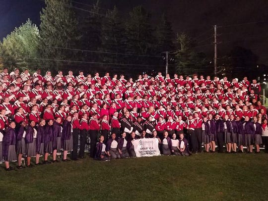 The Jackson Memorial Marching Band poses after winning