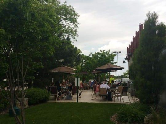 Customers enjoy their meals on Trepanier's BackYard