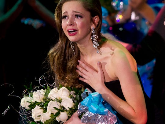 Madeline Kumm, left, reacts after being announced as the 2015 Miss Wisconsin Rapids Area during the Miss Wisconsin Rapids Area Scholarship Pageant at the Performing Arts Center, Saturday, Oct. 25, 2014.