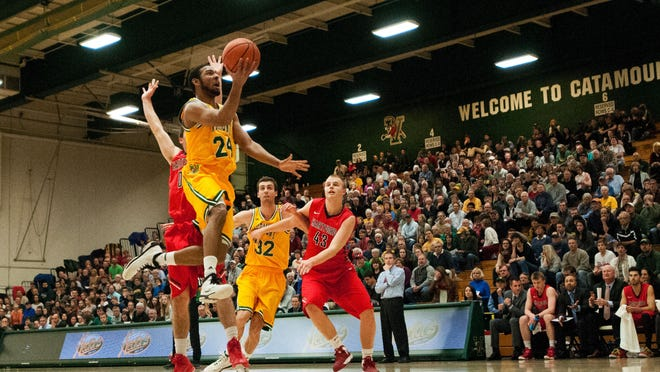 Guard Dre Wills (24) leaps for a layup during the men's basketball game between the Hartford Hawks and the Vermont Catamounts earlier this season.
