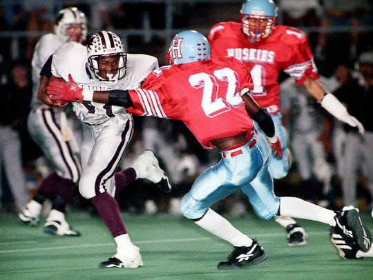 Hirschi defender Michael Peterson (22) tries to stop