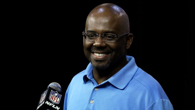 Detroit Lions general manager Martin Mayhew smiles about a question April 18, 2013.