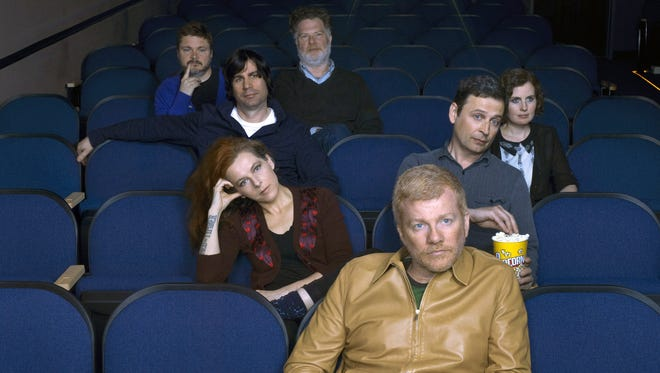 This image released by Sacks & Co. shows members of The New Pornographers, Carl Newman, front, second row from left, Neko Case and Kurt Dahle, third row from left, Todd Fancey and Kathryn Calder, back row from left, Blaine Thurier and John Collins.