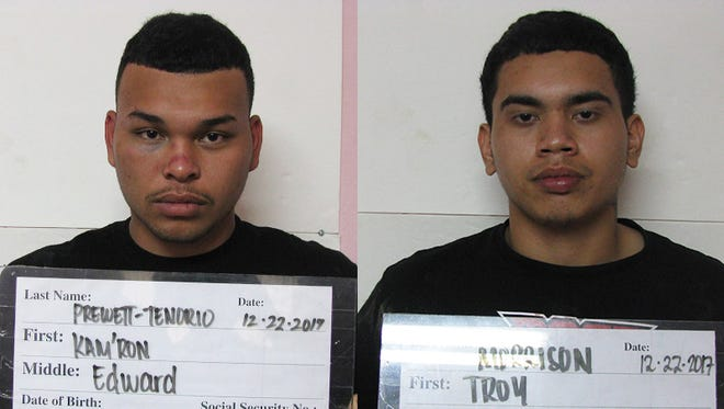 Kam'ron Edward Prewett-Tenorio, left, and Troy Allen Aguon Morrison, right, were arrested in connection with the armed robbery of an Agat store.