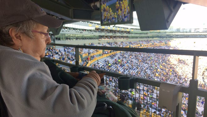 Carolyn Cochrun, 66, of Penn Valley, Calif., watches the Green Bay Packers warm up on the field before their game against the Dallas Cowboys at Lambeau Field on Sunday, Oct. 16, 2016. Cochrun and her son, Jim, traveled to Wisconsin and attended the game compliments of the Dream Foundation, which grants final dreams for adults who are terminally ill. Carolyn Cochrun has breast cancer.