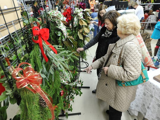 Shoppers look for wreaths at a previous Milton Holly Festival, an annual December tradition in the Sussex  County town.