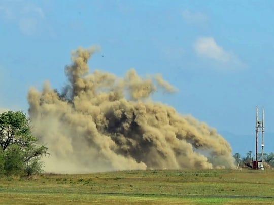 The demilitarization team detonates rocket motors as dust billows. Letterkenny Munitions Center (LEMC) held a tour for invited guests on Wednesday, September 28, 2016.