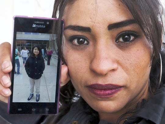 Rosa Mani Arias, 34, shows a recent photo of her daughter,