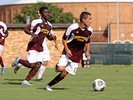 Midwestern State's Carlos Flores dribbles upfield during an intra-squad scrimmage Tuesday, Aug. 22, 2017, at the MSU Soccer Field. MSU Men's Soccer will play Fort Lewis (Colo.) soccer Sept. 1 at the university's soccer field.