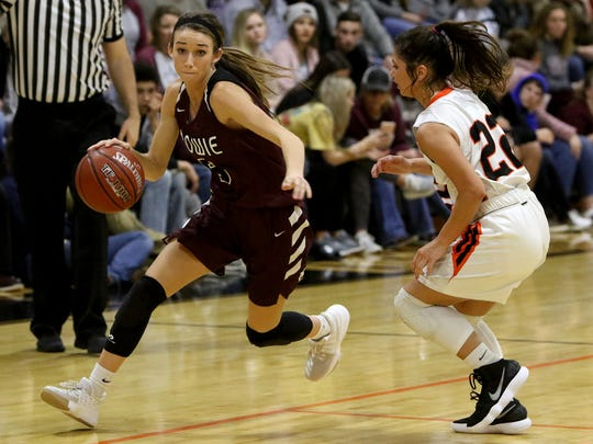 Bowie's Kamryn Cantwell drives to the basket next to Nocona's Brooke O'Neal Tuesday, Dec. 19, 2017, in Nocona.