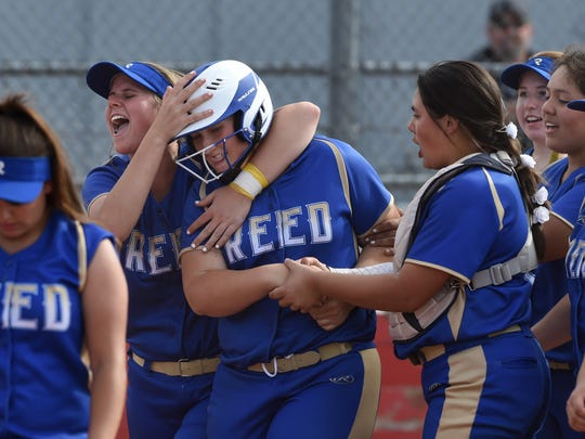Reed celebrates with Ally Boyd, center, after she hit a home run during Thursday's game at Wooster.