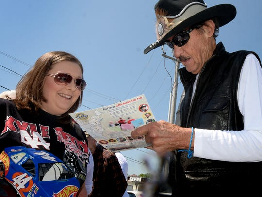 Former NASCAR driver Richard Petty signs a card for Danielle Wiseman of Spring Grove during an autograph session at 1st Capital Harley-Davidson Wednesday, May 9, 2018.  Petty won a NASCAR National Short Track Series race at Lincoln Speedway in 1961. That win is not included among Petty's career NASCAR win total of 200.