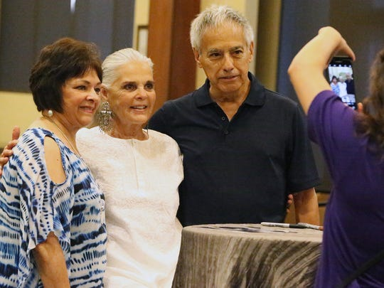 "Actress, author and activist Ali MacGraw poses for a photo with Becky Ramirez, left, and Luis Fierro of El Paso during an autograph-signing event Saturday at the El Paso Community Foundation Room at 333 N. Oregon St. MacGraw is in town as a special guest of the Plaza Classic Film Festival. Two of her films, ""Love Story"" and ""The Getaway,"" were screened at the festival."