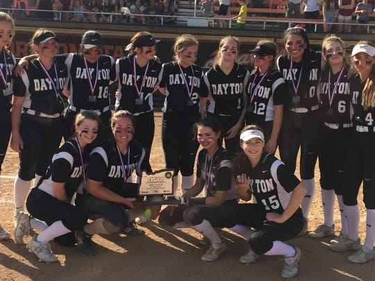 Dayton's softball team poses with its second place trophy from the OSAA Class 3A state championship game at the OSU Softball Complex on Friday, June 2, 2017.