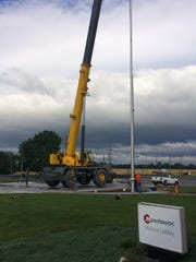 A Grove crane on May 26, 2017, sets an 80-foot pole