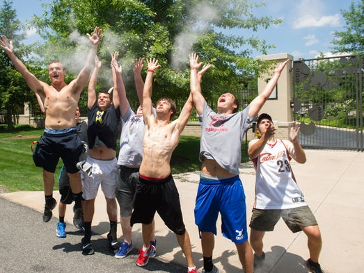 Fans celebrate in front of the house of LeBron James' house in Bath, Ohio.