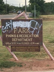 The sign at the entrance to Kirby Park, off of South 14th Street, east of Treadaway Boulevard, was vandalized about two weeks ago. It has since been painted over.