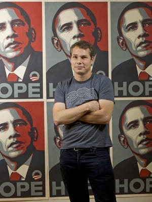** FILE ** In this Monday, Jan. 12, 2009 file photo, Los Angeles street artist Shepard Fairey poses for a picture with his Barack Obama Hope artwork in the Echo Park area of Los Angeles. Fairey, who created a famous image of Barack Obama before he became president has sued The Associated Press saying Fairey did not violate the AP copyright of a 2006 photograph. The AP has said it is owed credit and compensation for the artist's rendition of the picture. (AP Photo/Damian Dovarganes)