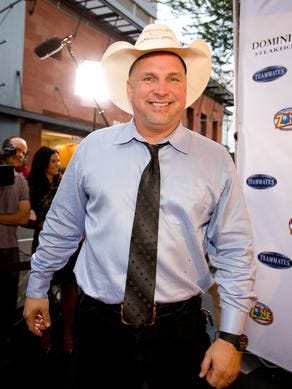 Garth Brooks, pictured here at a 2012 charity event in the Valley, announced his first Phoenix area shows in nearly 20 years on Sept. 2, 2015.