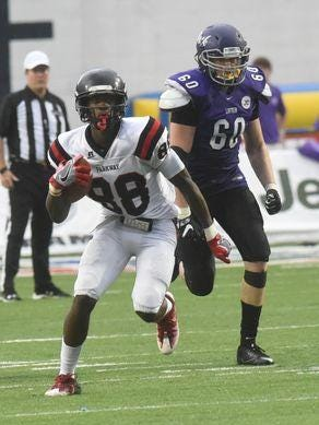 Parkway's Terrace Marshall Jr. looks to run after the catch in the Panthers' 69-54 win over Lufkin.