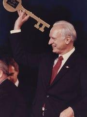 William Hudnut receives a key.