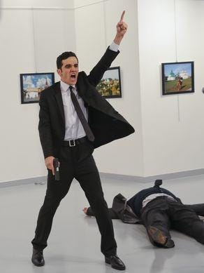 Mevlüt Mert Altıntaş gestures after shooting the Russian ambassador to Turkey, Andrei Karlov, at a photo gallery in Ankara, Turkey, on Dec. 19, 2016.
